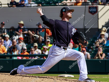 Stock Image of Lakeland, Florida, USA- Detroit Tigers relief pitcher Mark Lowe (21) throws a pitch in the 5th inning at Publix Field at Joker Marchant Stadium