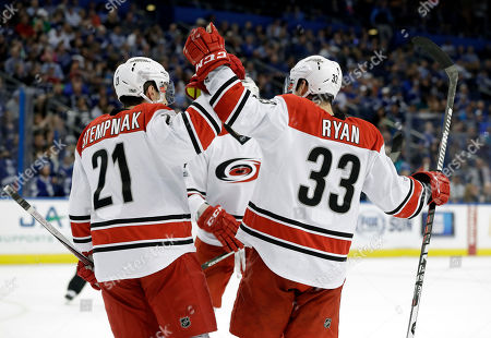 Derek Ryan, Lee Stempniak Carolina Hurricanes center Derek Ryan (33) celebrates with right wing Lee Stempniak (21) after Ryan scored against the Tampa Bay Lightning during the first period of an NHL hockey game, in Tampa, Fla