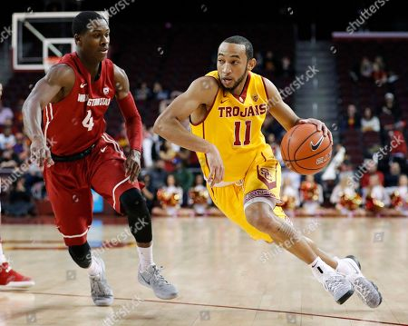 Jordan McLaughlin, Viont'e Daniels Southern California's Jordan McLaughlin, right, drives past Washington State's Viont'e Daniels during the second half of an NCAA college basketball game, in Los Angeles