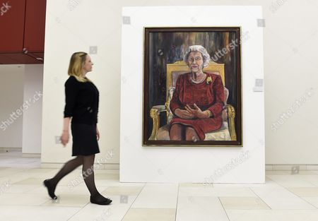 Victoria Parkinson Walks Next to a Painting of Britain's Elizabeth Ii by Welsh Artist Dan Llywelyn Hall at the Haymarket Virgin Money Lounge in London Britain 11 May 2016 the Exhibition Also Features Portraits of Amy Winehouse and David Bowie Michael Palin Sir Michael Caine Among Others to Commemorate the Anniversary of the End of the First World War with the War Memorials Trust and the Victoria Cross Trust Will Be the Charitable Beneficiaries of the Exhibition the Exhibition Runs From 09 May to 04 May United Kingdom London