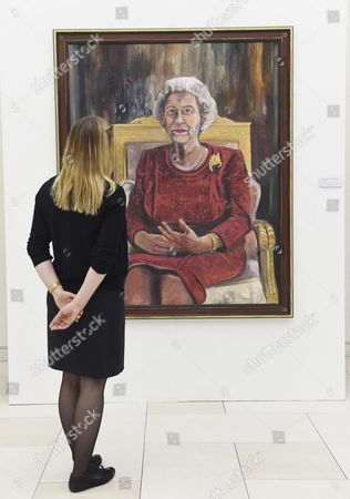 Stock Photo of Victoria Parkinson Poses Next to a Painting of Britain's Elizabeth Ii by Welsh Artist Dan Llywelyn Hall at the Haymarket Virgin Money Lounge in London Britain 11 May 2016 the Exhibition Also Features Portraits of Amy Winehouse and David Bowie Michael Palin Sir Michael Caine Among Others to Commemorate the Anniversary of the End of the First World War with the War Memorials Trust and the Victoria Cross Trust Will Be the Charitable Beneficiaries of the Exhibition the Exhibition Runs From 09 May to 4 May United Kingdom London