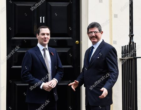 Britain's Chancellor of the Exchequer George Osborne (l) Greets His Brazilian Counterpart Minister of Finance Joaquim Levy (r) on the Steps of N11 Downing Street in London Britain 29 October 2015 United Kingdom London