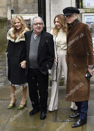 Stock Photo of British Musicians Bill Wyman (2-l) and Bob Geldof (r) Arrive with Their Wifes Suzanne Accosta (l) and Jeanne Marine (2-r) at St Bride's Church For a Service to Celebrate the Wedding Between Australian-born Us Media Mogul Rupert Murdoch and Former Us Model Jerry Hall in London Britain 05 March 2016 United Kingdom London