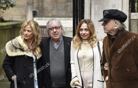 Stock Image of British Musicians Bill Wyman (2-l) and Bob Geldof (r) Arrive with Their Wifes Suzanne Accosta (l) and Jeanne Marine (2-r) at St Bride's Church For a Service to Celebrate the Wedding Between Australian-born Us Media Mogul Rupert Murdoch and Former Us Model Jerry Hall in London Britain 05 March 2016 United Kingdom London