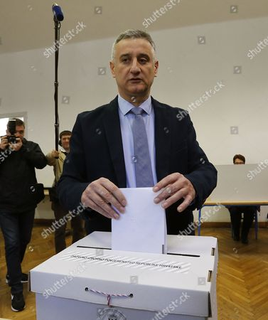 Tomislav Karamarko Leader of the Croatian Democratic Union (hdz) Casts His Vote in the Croatian Parliamentary Election Into a Ballot Box at a Polling Station in Downtown Zagreb Croatia 08 November 2015 Croatian Parliamentary Elections Are Set to Be the Closest Since the Country Claimed Independence a Quarter Century Ago with the Final Outcome Hinging on Too Many Factors For a Clear-cut Forecast Incubent Prime Minister Zoran Milanovic Seeks a Second Consecutive Term For His Social Democrats (sdp) and the Third Overall For the Party Since Croatia Split From the Former Yugoslavia in 1991 the Sdp Trailed the Hdz in Months Leading Up to the Election But Have Since Closed the Gap to Less Than 1 Percentage Point Croatia Zagreb
