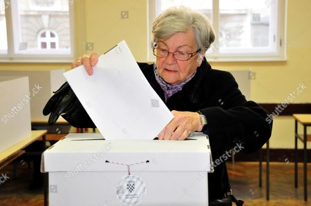An Elderly Croatian Woman Casts Her Vote For the Parliamentary Elections Into the Ballot Box at a Polling Station in Zagreb Croatia 08 November 2015 Croatian Parliamentary Elections Sunday Are Set to Be the Closest Since the Country Claimed Independence a Quarter Century Ago with the Final Outcome Hinging on Too Many Factors For a Clear-cut Forecast Incubent Prime Minister Zoran Milanovic Seeks a Second Consecutive Term For His Social Democrats (sdp) and the Third Overall For the Party Since Croatia Split From the Former Yugoslavia in 1991 Croatia Zagreb