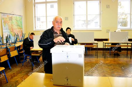 An Elderly Croatian Man Cast His Vote For the Parliamentary Elections Into the Ballot Box at a Polling Station in Zagreb Croatia 08 November 2015 Croatian Parliamentary Elections Sunday Are Set to Be the Closest Since the Country Claimed Independence a Quarter Century Ago with the Final Outcome Hinging on Too Many Factors For a Clear-cut Forecast Incubent Prime Minister Zoran Milanovic Seeks a Second Consecutive Term For His Social Democrats (sdp) and the Third Overall For the Party Since Croatia Split From the Former Yugoslavia in 1991 Croatia Zagreb