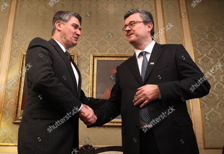 Outgoing Croatian Prime Minister Zoran Milanovic (l) Shakes Hands with His Successor Tihomir Oreskovic in Zagreb 22 January 2016 Croatia's Parliament Late 22 January Backed the Country's New Prime Minister Tihomir Oreskovic and His Centre-right Cabinet with 83 Votes in Favour 63 Against and Five Abstentions Oreskovic Two Deputy Premiers and 17 Ministers Were Sworn in Immediately After the Marathon 14-hour Debate Croatia Zagreb