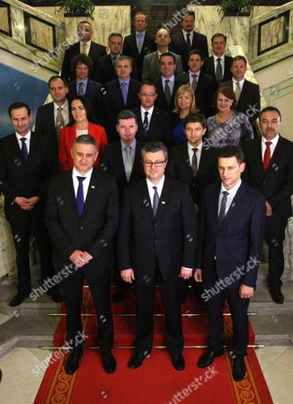 New Croatian Prime Minister Tihomir Oreskovic (front C) Flanked by First Deputy Prime Minister Tomislav Karamarko (l) and Second Deputy Prime Minister Bozo Petrov (r) Pose with Members of the Cabinet at the Parliament in Zagreb 22 January 2016 Croatia's Parliament Late 22 January Backed the Country's New Prime Minister Tihomir Oreskovic and His Centre-right Cabinet with 83 Votes in Favour 63 Against and Five Abstentions Second Row From Left Are Foreign Minister Miro Kovac Minister of Public Administration Dubravka Jurlina Alibegovic Minister of Healthcare Dario Nakic Finance Minister Zdravko Maric Interior Minister Vlaho Orepic Third Row (l-r) Minster of Environment Slaven Dobrovic Minister of Culture Zlatko Hasanbegovic Minister of Social Policy and Youth Bernardica Juretic Minster of Labour Nada Sikic Fourth Row (l-r) Minister of Science and Education Predrag Sustar Minister of Business and Trade Darko Horvat Minister of Defense Josip Buljevic Minister of Maritime Affairs Transport and Infrastructure Oleg Butkovic Minister of Economy Tomislav Panenic Fifth Row (l-r) Minister of Veterans Mijo Crnoja Minister of Tourism Anton Kliman Minister of Justice Ante Sprlje Minister of Regional Development and Eu Funds Tomislav Tolusic Minister of Construction Lovro Kuscevic and Minister of Agriculture Davor Romic Croatia Zagreb