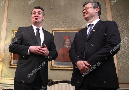 Outgoing Croatian Prime Minister Zoran Milanovic (l) and His Successor Tihomir Oreskovic in Zagreb 22 January 2016 Croatia's Parliament Late 22 January Backed the Country's New Prime Minister Tihomir Oreskovic and His Centre-right Cabinet with 83 Votes in Favour 63 Against and Five Abstentions Oreskovic Two Deputy Premiers and 17 Ministers Were Sworn in Immediately After the Marathon 14-hour Debate Croatia Zagreb