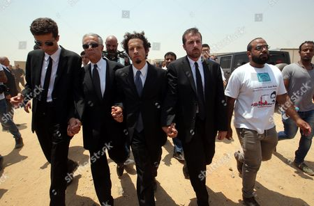 The Sons of 1999 Nobel Chemistry Laureate Ahmed Zewail Nabeel (left) and Hani (centre) Lead Mourners During the Funeral of Their Father an Egyptian-us Professor at Zewail City in Giza 07 August 2016 Ahmed Zewail Died in the Us Aged 70 He Won the Nobel Chemistry Prize in 1999 For His Study of Chemical Reaction in Extremely Short Timescales Also Known As Femtochemistry to Be the First Arab Scientist to Win the Nobel Prize Egypt Giza