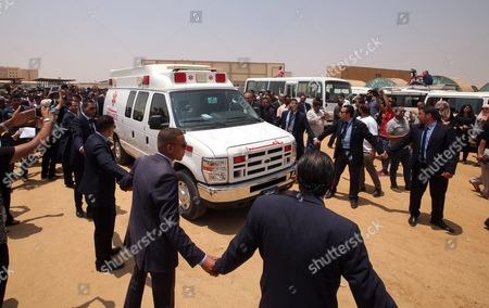 Egyptian Mourners Surround an Ambulance Carrying the Coffin of Chemistry Nobel Prize Laureate of 1999 Egyptian - Us Professor Ahmed Zewail on Its Arrival the Funeral of Ahmed Zewail at Zewail City in Giza 07 August 2016 Ahmed Zewail Died in the Us Aged 70 He Won the Nobel Chemistry Prize in 1999 For His Study of Chemical Reaction in Extremely Short Timescales Also Known As Femtochemistry to Be the First Arab Scientist to Win the Nobel Prize He Will Be Buried in Egypt on 07 August 2016 Egypt Giza
