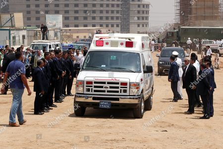 Stock Picture of Egyptian Mourners Surround an Ambulance Carrying the Coffin of Chemistry Nobel Prize Laureate of 1999 Egyptian - Us Professor Ahmed Zewail on Its Arrival During His Funeral at Zewail City in Giza 07 August 2016 Ahmed Zewail Died in the Us Aged 70 He Won the Nobel Chemistry Prize in 1999 For His Study of Chemical Reaction in Extremely Short Timescales Also Known As Femtochemistry to Be the First Arab Scientist to Win the Nobel Prize He Will Be Buried in Egypt on 07 August 2016 Egypt Giza