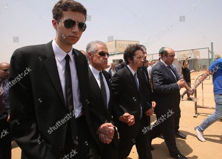 The Sons of 1999 Nobel Chemistry Laureate Ahmed Zewail Nabeel (left) and Hani (third From Left) Lead Mourners During the Funeral of Their Father an Egyptian-us Professor at Zewail City in Giza 07 August 2016 Ahmed Zewail Died in the Us Aged 70 He Won the Nobel Chemistry Prize in 1999 For His Study of Chemical Reaction in Extremely Short Timescales Also Known As Femtochemistry to Be the First Arab Scientist to Win the Nobel Prize Egypt Giza