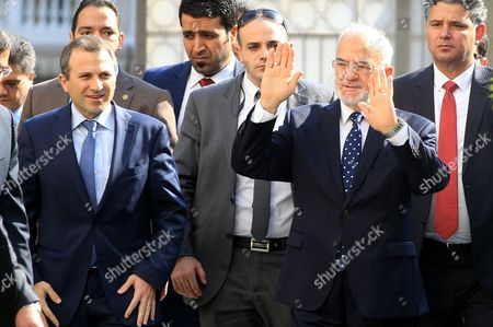 Iraqi Foreign Minister Ibrahim Al-jafari (r and Lebanese Minister of Foreign Affairs Gibran Bassil (l) Gestures Upon Arrival to Attend the Arab Foreign Ministers Emergency Meeting at the League Headquarters in Cairo Egypt 10 January 2016 the Arab League Foreign Ministers Meet in Cairo to Discuss the Saudi-iranian Tensions Egypt Cairo