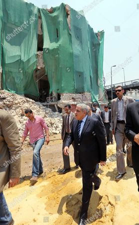Egyptian Prime Minister Ibrahim Mahlab (c) Visits the Site of an Explosion at the Italian Consulate in Downtown Cairo Egypt 13 July 2015 the Italian Foreign Minister Visited the Italian Consulate 13 July Much of Which was Destroyed in a Large Car Bomb Explosion 11 July Which Killed One and Wounded Eight an Attack Coming Shortly After Another Bombing 29 June in Which Egypt's Prosecutor General Hisham Barakat was Killed Egypt Cairo