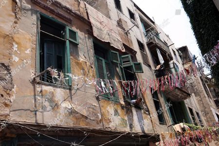 A Young Resident of the Impoverished Bulaq Neighborhood Looks Down Into an Alley Decorated For Ramadan During a Visit by the Egyptian Prime Minister Ibrahim Mahlab (not Pictured) to the Site of an Explosion Outside the Italian Consulate in Downtown Cairo Egypt 13 July 2015 the Italian Foreign Minister Visited the Italian Consulate 13 July Much of Which was Destroyed in a Large Car Bomb Explosion 11 July Which Killed One and Wounded Eight an Attack Coming Shortly After Another Bombing 29 June in Which Egypt's Prosecutor General Hisham Barakat was Killed Egypt Cairo