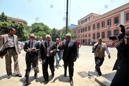 Egyptian Prime Minister Ibrahim Mahlab (center - L) Visits the Site of an Explosion Outside the Italian Consulate in Downtown Cairo Egypt 13 July 2015 the Italian Foreign Minister Visited the Italian Consulate 13 July Much of Which was Destroyed in a Large Car Bomb Explosion 11 July Which Killed One and Wounded Eight an Attack Coming Shortly After Another Bombing 29 June in Which Egypt's Prosecutor General Hisham Barakat was Killed Egypt Cairo