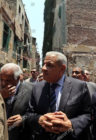 Egyptian Prime Minister Ibrahim Mahlab (c) Meets People Living in the Area Around the Site of an Explosion Outside the Italian Consulate in Downtown Cairo Egypt 13 July 2015 the Italian Foreign Minister Visited the Italian Consulate 13 July Much of Which was Destroyed in a Large Car Bomb Explosion 11 July Which Killed One and Wounded Eight an Attack Coming Shortly After Another Bombing 29 June in Which Egypt's Prosecutor General Hisham Barakat was Killed Egypt Cairo