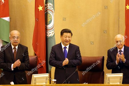 Arab League Secretary General Nabil Al-arabi (r) and Egyptian Prime Minister Sherif Ismail (l) Welcome the Chinese President Xi Jinping (c) at the Arab League Headquarter in Cairo Egypt 21 January 2016 Chinese President Xi Jinping Arrived in Egypt on 20 January Part of a Three-nation Tour That Has Already Taken Him to Saudi Arabia Egypt Cairo
