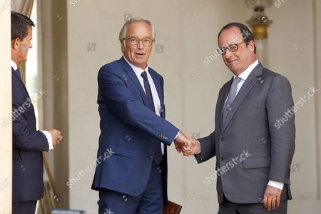 French President Francois Hollande (r) Greets French Labor Minister Francois Rebsamen (c) As French Prime Minister Manuel Valls (l) Looks on Following the Cabinet Meeting at the Elysee Palace in Paris France 02 September 2015 France Paris