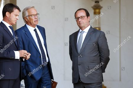 French Labor Minister Francois Rebsamen (c) Talks with French Prime Minister Manuel Valls (l) As French President Francois Hollande (r) Looks on Following the Cabinet Meeting at the Elysee Palace in Paris France 02 September 2015 France Paris