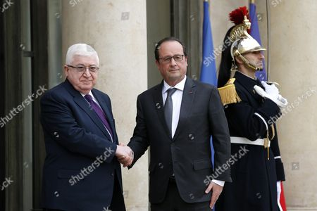 French President Francois Hollande (c) Greets Iraqi President Fouad Massoum (l) Prior to Their Meeting at the Elysee Palace in Paris France 02 December 2015 France Paris