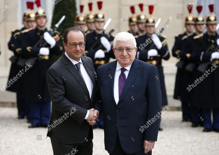 French President Francois Hollande (l) Greets Iraqi President Fouad Massoum Prior to Their Meeting at the Elysee Palace in Paris France 02 December 2015 France Paris
