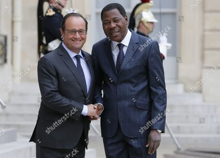 French President Francois Hollande (l) Greets Benin's President Thomas Boni Yayi (r) As He Arrives For a Meeting at the Elysee Palace in Paris France 18 August 2015 France Paris