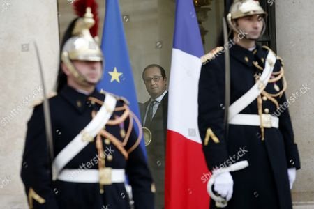 French President Francois Hollande (c) Walks in the Elysee Palace After His Meeting with Iraqi President Fouad Massoum (not Pictured) in Paris France 02 December 2015 France Paris
