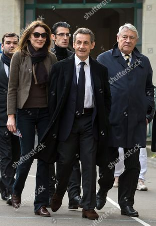 (l-r) Carla Bruni-sarkozy French Former President Nicolas Sarkozy and 16th Arrondissement Mayor Claude Goasguen Arrive at the Lycee Lafontaine to Vote For the French Regional Elections First Round in Paris France 06 December 2015 France Goes to the Polls in a Two-round Regional Election on 06 and 13 December 2015 France Paris