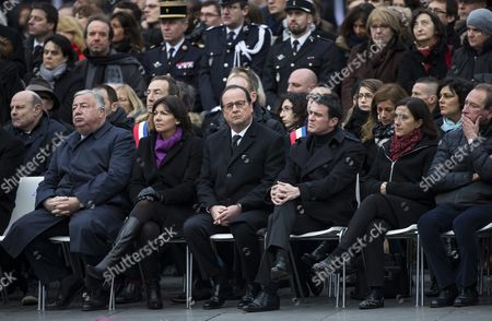 (l-r) French Interior Minister Bernard Cazeneuve Justice Minister Christiane Taubira Foreign Affairs Minister Laurent Fabius French Senate President Gerard Larcher Mayor of Paris Anne Hidalgo French President Francois Hollande French Prime Minister Manuel Valls Deputy of Paris Sandrine Mazetier Former Mayor of Paris Bertrand Delanoe Attend a Commemoration Ceremony to Mark the One-year Anniversary of the Unity March Which Had Gathered Over a Million People in the Wake of the Charlie Hebdo and Hypercacher Supermarket Attacks Held on Place De La Republique in Paris 10 January 2016 During the Ceremony French President Francois Hollande Inaugurated a Newly Planted Oak Tree on the Square Which Has Become the Focal Point For Remembrance Rallies For Victims of the Islamist Attacks in Paris Including the More Recent November 2015 Attacks on Cafes and the Bataclan Concert Venue France Paris