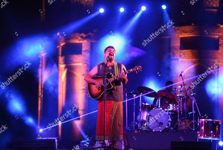 Stock Picture of Indian Band Led by Raghu Dixit Perform During the 'Light the Way Event' to Celebrate the Adoption of Global Goals by Indian Prime Minister Narendra Modi at the Old Fort in New Delhi India 24 September 2015 Indian Prime Minister Along with Other World Leaders Will Adopt the Global Goals to Tackle the Issues of Poverty Inequality and Climate Change at the Un Summit Which is Going to Be Held in New York on 25 September 2015 India New Delhi