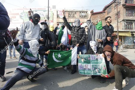 Kashmiri Muslim Protestors Hold Pakistani Flags and Posters of Pakistani Leaders and Kashmiri Separatist Leader Mirwaiz Moulvi Muhammad Umar Farooq During a Protest in Srinagar the Summer Capital of Indian Kashmir 13 November 2015 Chairman of the Hardline Faction of the All Parties Hurriyat (freedom) Conference Syed Ali Geelani Had Called For Protests Following Friday Congregation Prayers Against the Killing of a 22-year-old Gowhar Nazir Dar Allegedly by Paramilitary Crpf Soldiers on 07 November 2015 India Srinagar