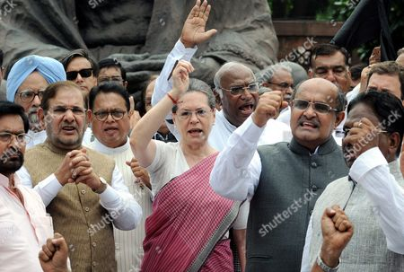 Indian Congress President Sonia Gandhi (4-l) and Other Congress Lawmakers and Opposition Party Members Shout Slogans During a Protest Against the Week Long Suspension of 25 Lawmakers From Their Party by Lok Sabha Speaker Sumitra Mahajan by a Statue of Mahatma Gandhi Outside the Indian Parliament Building in New Delhi India 05 August 2015 According to Reports 03 August the Speaker of India's Parliament Suspended 25 Lawmakers From the Main Opposition Party For Causing 'Grave Disorder' with Repeated Disruptions Indian National Congress Party Members Have Hindered Parliament's Ability to Carry out Business Since the Monsoon Session Began 21 July and Demanded the Resignations of Two Leaders From the Ruling Bharatiya Janata Party (bjp) For Their Alleged Favors For Lalit Modi the Architect of India's Lucrative Cricket Premier League Now Under Investigation For Financial Irregularities India New Delhi
