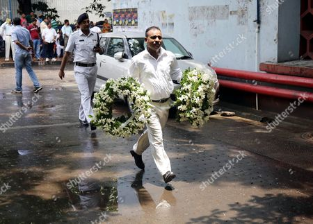 Stock Picture of An Indian Man Carries Floral Tribute to Late Mahasweta Devi in Calcutta Eastern India 29 July 2016 Social Writer and Activist Mahasweta Devi Passed Away at the Age of 90 on 28 July Mahasweta Devi was Born in Undivided India's Dhaka (now in Bangladesh) in 1926 Into a Family of Writers She was a Bengali Fiction Writer a Social Activist a Crusader For the Tribal Communities and a Feminist India Calcutta