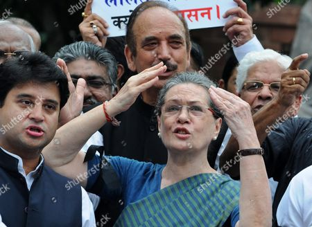 Indian Congress President Sonia Gandhi (c) Shouts Slogans During a Protest Against the Week Long Suspension of 25 Lawmakers From Their Party by Lok Sabha Speaker Sumitra Mahajan in New Delhi 07 August 2015 According to Reports 03 August the Speaker of India's Parliament Suspended 25 Lawmakers From the Main Opposition Party For Causing 'Grave Disorder' with Repeated Disruptions Indian National Congress Party Members Have Hindered Parliament's Ability to Carry out Business Since the Monsoon Session Began 21 July and Demanded the Resignations of Two Leaders From the Ruling Bharatiya Janata Party (bjp) For Their Alleged Favors For Lalit Modi the Architect of India's Lucrative Cricket Premier League Now Under Investigation For Financial Irregularities India New Delhi
