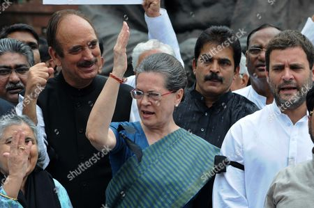 Indian Congress President Sonia Gandhi (c) and Party Vice President Rahul Gandhi (r) Shout Slogans During a Protest Against the Week Long Suspension of 25 Lawmakers From Their Party by Lok Sabha Speaker Sumitra Mahajan in New Delhi 07 August 2015 According to Reports 03 August the Speaker of India's Parliament Suspended 25 Lawmakers From the Main Opposition Party For Causing 'Grave Disorder' with Repeated Disruptions Indian National Congress Party Members Have Hindered Parliament's Ability to Carry out Business Since the Monsoon Session Began 21 July and Demanded the Resignations of Two Leaders From the Ruling Bharatiya Janata Party (bjp) For Their Alleged Favors For Lalit Modi the Architect of India's Lucrative Cricket Premier League Now Under Investigation For Financial Irregularities India New Delhi