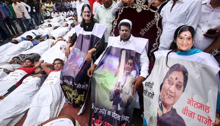Indian National Youth Congress Activists Wears a Mask Depicting Senior Bjp Leaders Vasundhara Raje (l) Sushma Swaraj (r) and Former Cricket Official Lalit Modi (c) As They Participate in a Street Play Along with Others During a Protest Against the Bjp Led Government in New Delhi India 11 August 2015 According to Local Reports Members of Indian Youth Congress Protested Ministers of the Bjp Led Government For Their Alleged Involvement in Various Scams Including the Recruitment Racket in Vyapam the Madhya Pradesh Professional Examination Board and Favours Offered to the Former Cricket Official Lalit Modi India New Delhi