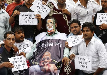 An Indian National Youth Congress Activist (c) Wears a Mask Depicting Indian Prime Minister Naredra Modi As He Participate in a Street Play Along with Others During a Protest Against the Bjp Led Government in New Delhi India 11 August 2015 According to Local Reports Members of Indian Youth Congress Protested Ministers of the Bjp Led Government For Their Alleged Involvement in Various Scams Including the Recruitment Racket in Vyapam the Madhya Pradesh Professional Examination Board and Favours Offered to the Former Cricket Official Lalit Modi India New Delhi