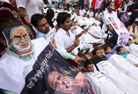 An Indian National Youth Congress Activist (l) Wears a Mask Depicting Indian Prime Minister Naredra Modi As He Participate in a Street Play Along with Others During a Protest Against the Bjp Led Government in New Delhi India 11 August 2015 According to Local Reports Members of Indian Youth Congress Protested Ministers of the Bjp Led Government For Their Alleged Involvement in Various Scams Including the Recruitment Racket in Vyapam the Madhya Pradesh Professional Examination Board and Favours Offered to the Former Cricket Official Lalit Modi India New Delhi