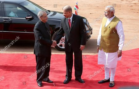Stock Picture of Indian Prime Minister Narendra Modi (r) and Indian President Pranab Mukherjee (l) Welcome the President of Seychelles James Michel During His Ceremonial Reception at the Indian President's House in New Delhi India 26 August 2015 President James Michel is in India on a State Visit to Strengthen the Political and Bilateral Ties Between the Two Countries India New Delhi
