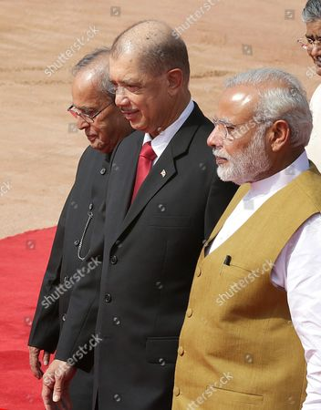 Indian President Pranab Mukherjee (l) and Indian Prime Minister Narendra Modi (r ) Walk with the President of the Seychelles James Michel During His Ceremonial Reception at the Indian President's House in New Delhi India 26 August 2015 President James Michel is in India on a State Visit to Strengthen the Political and Bilateral Ties Between the Two Countries India New Delhi