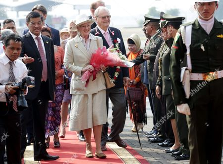 Danish Queen Margrethe Ii (c-l) Walks with Her Husband Prince Consort Henrik Among Indonesian Officers Shortly After Their Arrival at Sukarno Hatta International Airport in Jakarta Indonesia 21 October 2015 the Danish Queen Visits Indonesia For Five-days to Strengthened Relations Between the Two Countries Indonesia Jakarta