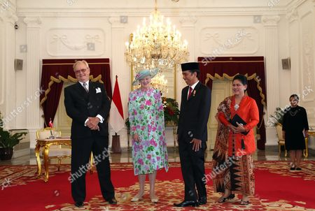 Denmark's Queen Margrethe Ii (2-l) Accompanied by Denmark's Prince Consort Henrik (l) Listens to Indonesian President Joko Widodo (2-r) As Indonesian First Lady Iriana (r) Looks on During a State Visit at Merdeka Palace in Jakarta Indonesia 22 October 2015 the Danish Queen is in Indonesia on a Five-day Visit to Strengthen Relations Between the Two Countries Indonesia Jakarta
