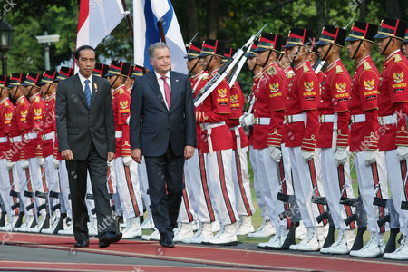 Finnish President Sauli Vainamo Niinisto (c) and Indonesian President Joko Widodo (l) Inspect the Honour Guard Before Their Meeting at the State Palace in Jakarta Indonesia 03 November 2015 Niinisto is on a Two Day Visit to Indonesia to Strengthen Ties Between the Two Nations Indonesia Jakarta