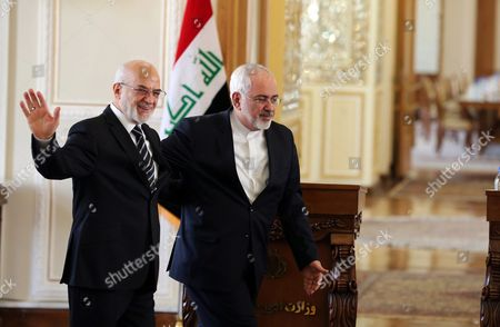 Iranian Foreign Minister Mohammad Javad Zarif (r) Greets His Iraqi Counterpart Ibrahim Al-jafari (l) After a Joint Press Conference in Tehran Iran 06 January 2016 Jafari is Visiting Iran Amid Growing Regional Dispute Surrounding Saudi Arabia's Weekend Execution of Dissident Shiite Cleric Nimr Al-nimr and After Saudi Arabia Bahrain and Kuwait Broke Off Diplomatic Relations with Iran Zarif on 06 January Said Iran Wants No Tension in the Region and Would Always Welcome Dialogue with Its Neighbors Iran (islamic Republic Of) Tehran