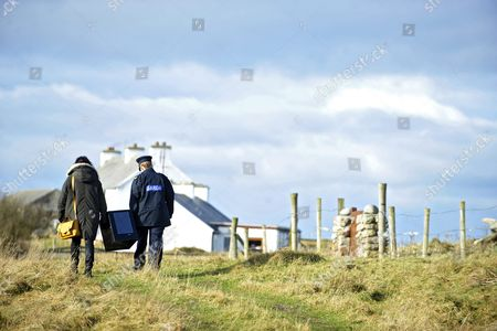 Garda Margaret Byrne (c) Member of the Irish National Police Force Carries a Ballot Box with Magella Harkin (l) From a Boat to the Polling Station on the Island of Innishfree where Two People Voted Off the Coast of Donegal in Ireland 25 February 2016 Over Two Thousand People Live on Islands Off the Coast of Ireland who Vote Early in the Irish General Election the Rest of the Country Go to the Polls on 26 February 2016 Ireland Innishree