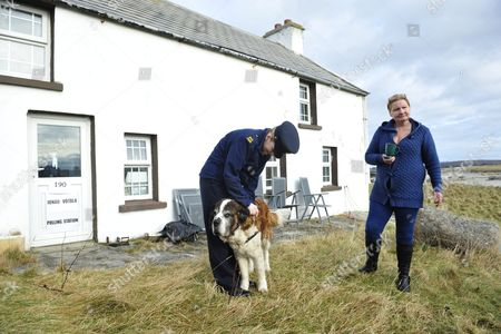 Garda Margaret Byrne (l) Member of the Irish National Police Force Pets the Dog of Philomena Currid (r) Whose Cottege was Used As a Polling Station on the Island of Inishfree Off the Coast of Donegal Ireland 25 February 2016 Over Two Thousand People Live on Islands Off the Coast of the Main Land and Have to Vote Early in the Irish General Election the Rest of the Country Go to the Polls on 26 February 2016 Ireland Inishfree