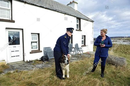 Garda Margaret Byrne (l) From the Irish National Police Force Pictured with Philomena Currid Whose Kitchen was Used As a Polling Station on the Island of Inishfree Off the Coast of Donegal in Ireland 25 February 2016 Over Two Thousand People Live on Islands Off the Coast of Ireland who Vote Early in the Irish General Election the Rest of the Country Go to the Polls on 26 February 2016 Ireland Inishfree
